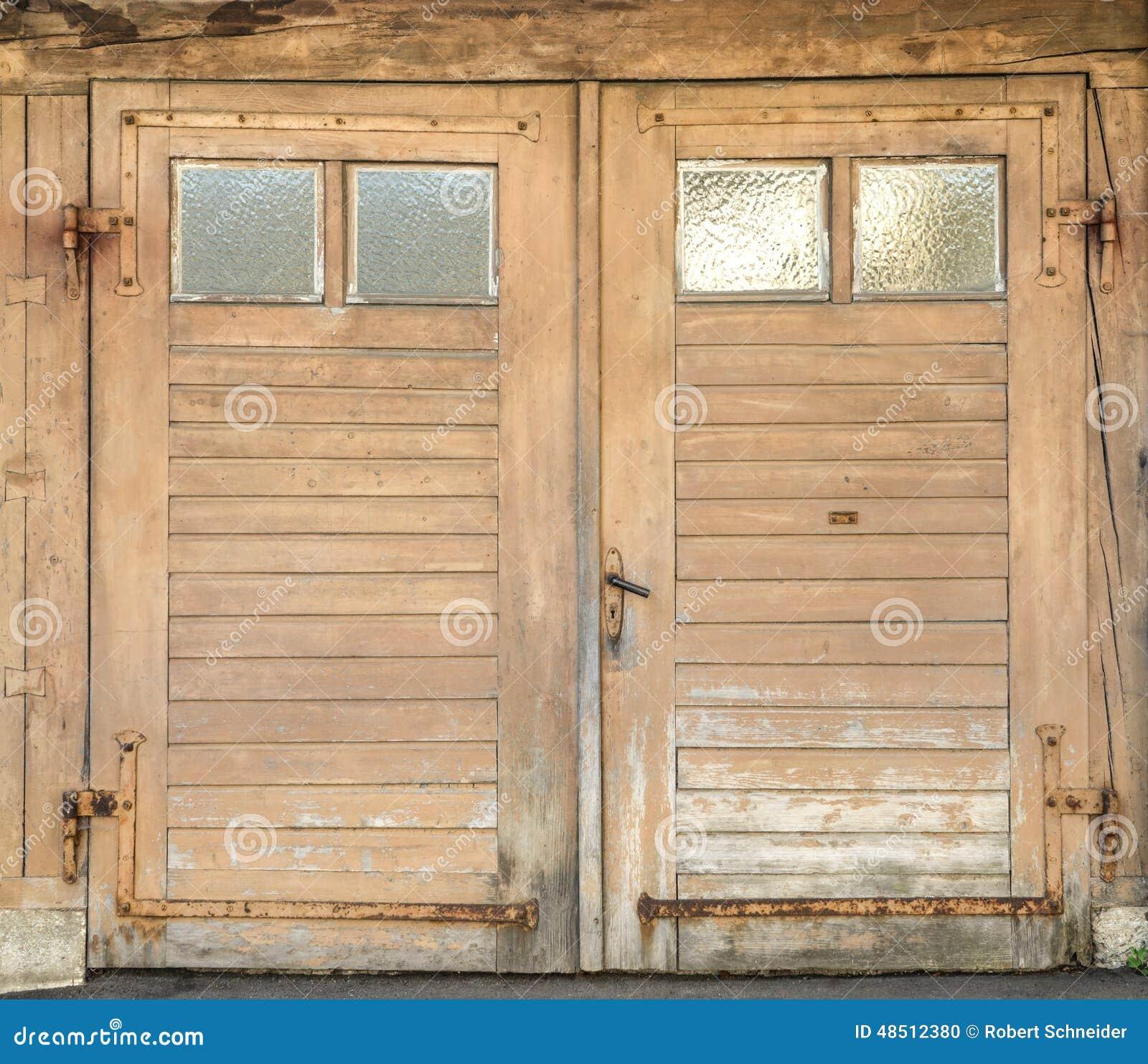 Old Garage Doors : Old garage door with four small windows stock photo