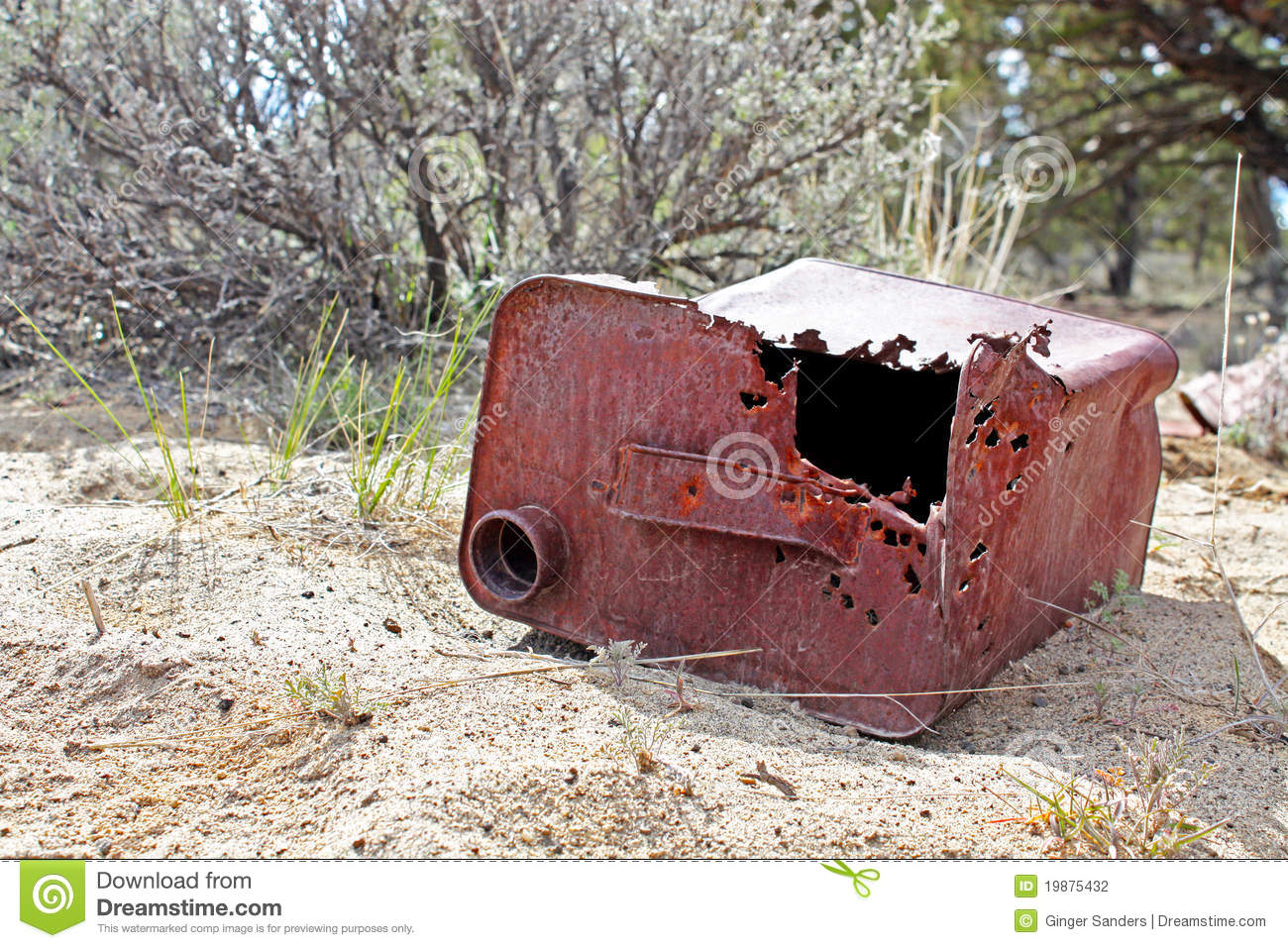 Old Gas Can Laying In Sand