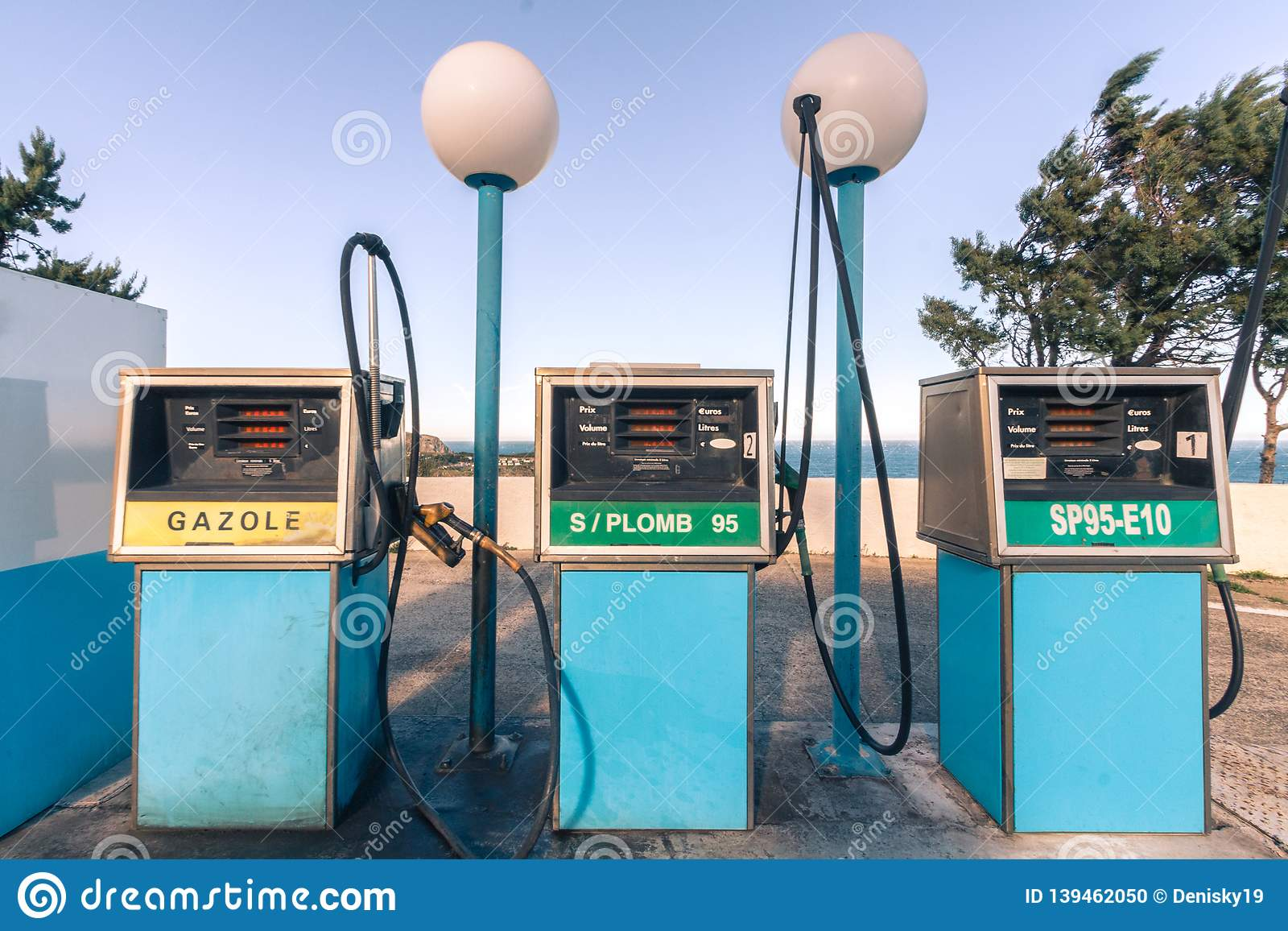 Old gas station in France. 80`s vintage style