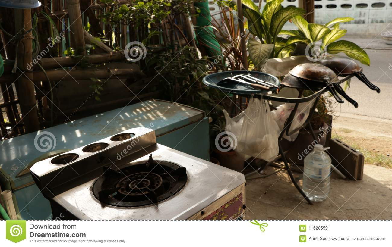 Old Gas Stove With Vintage Kitchen Utensils In The Garden Stock