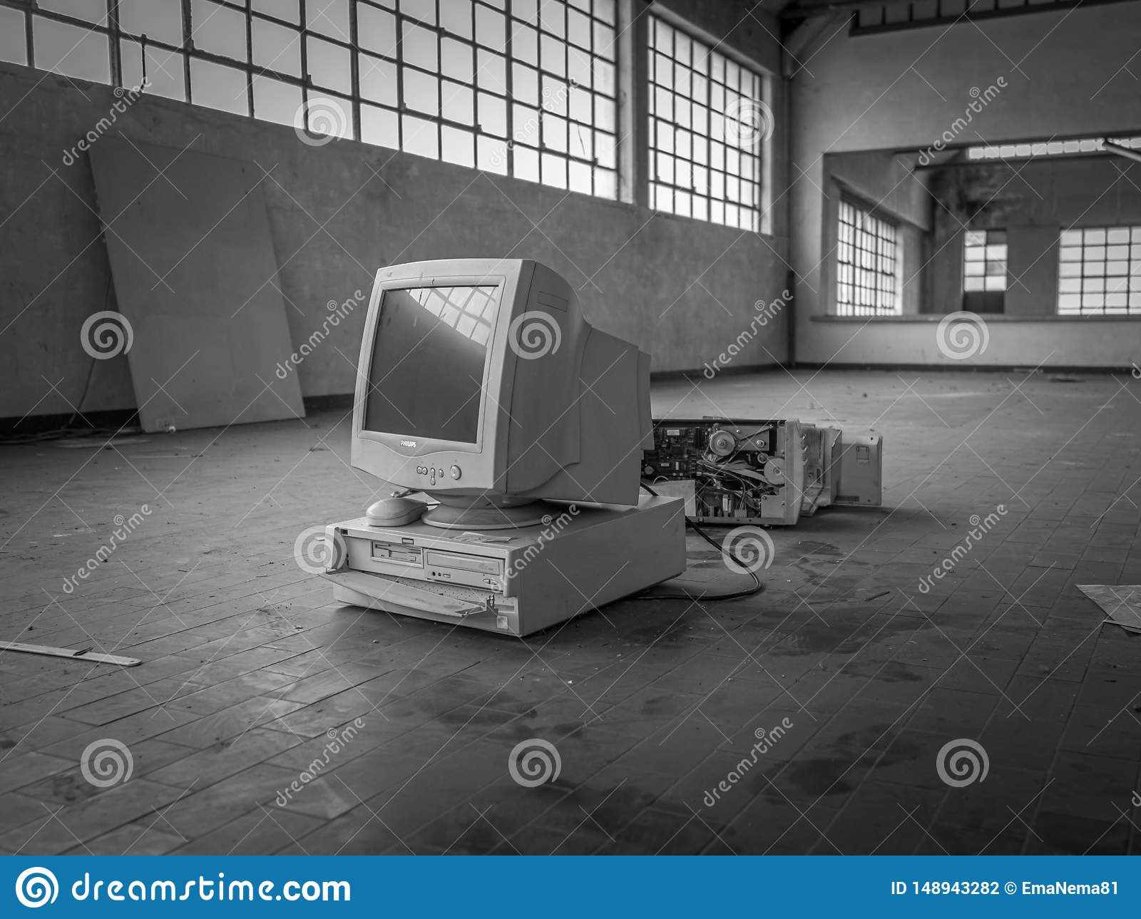 Old generation computer in warehouse, black and white.