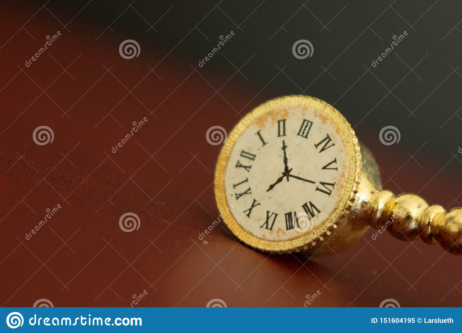 An old golden clock or watch showing the time running out.