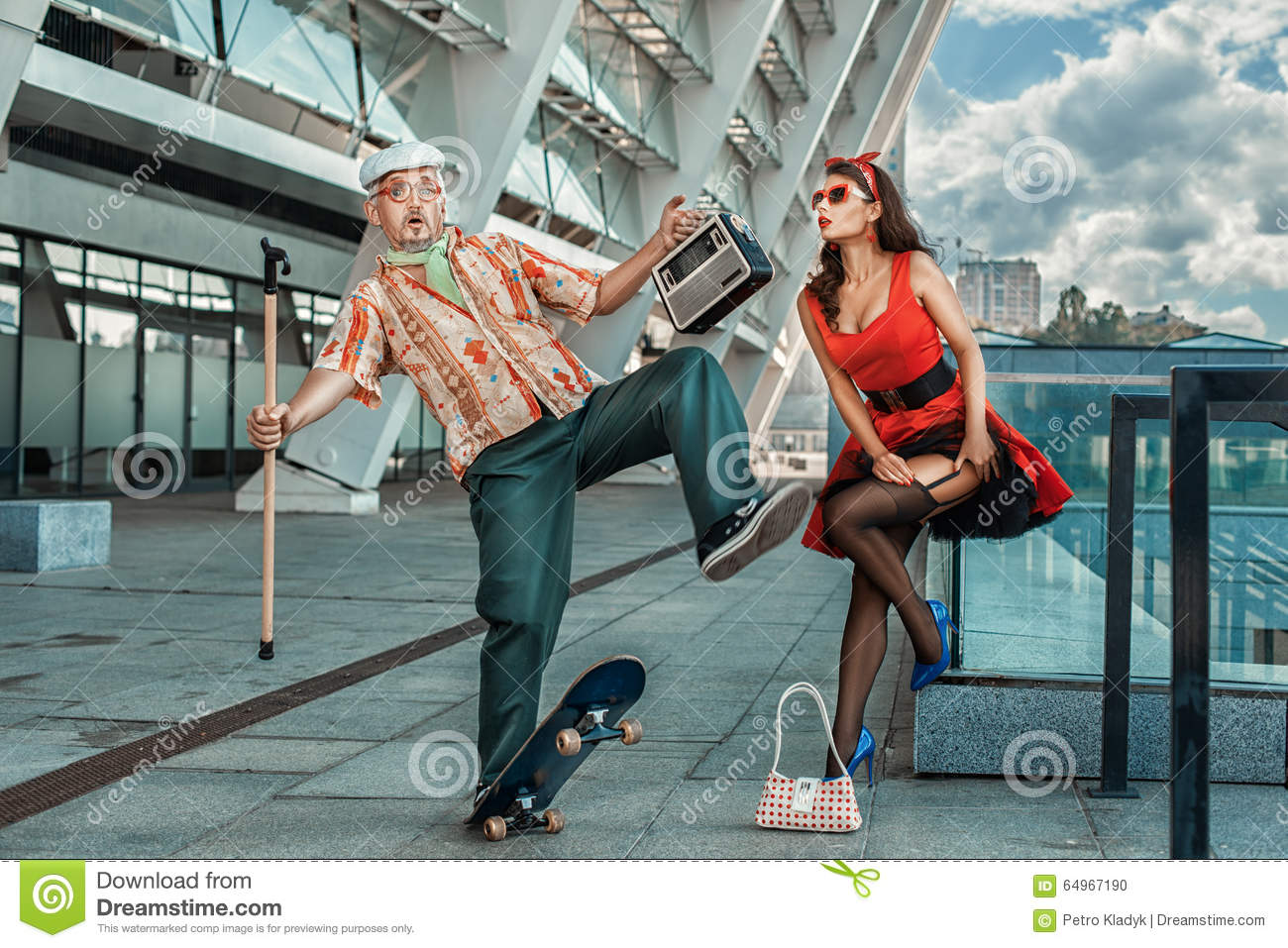 Old Grandfather Rides Skateboard Past The Girl. Stock Photo ...