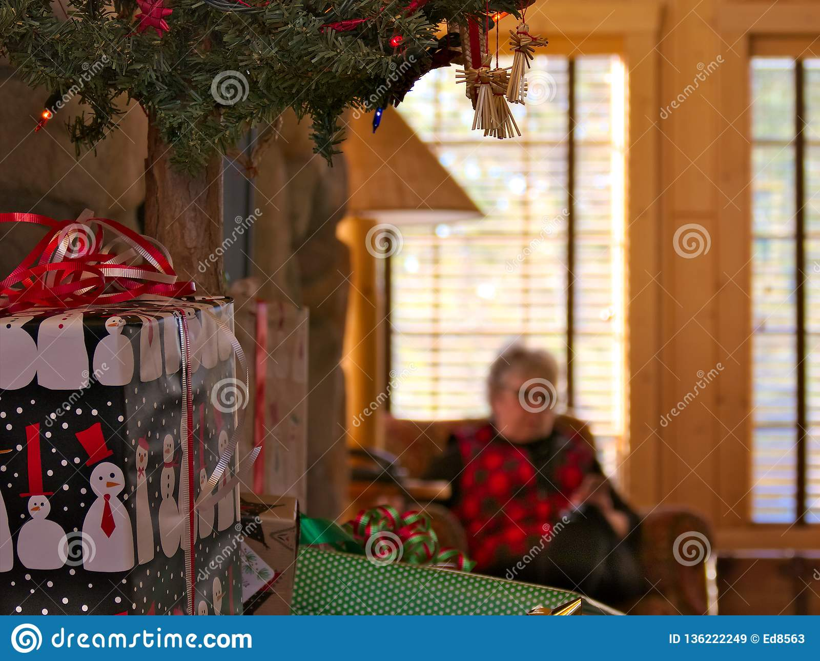 Old grandmother. senior lady enjoys mobile phone, smartphone at Christmas time