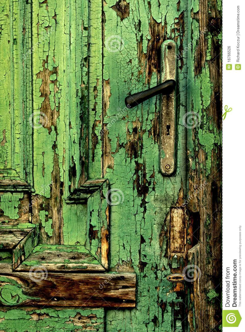 old green door close-up with handle stock photo