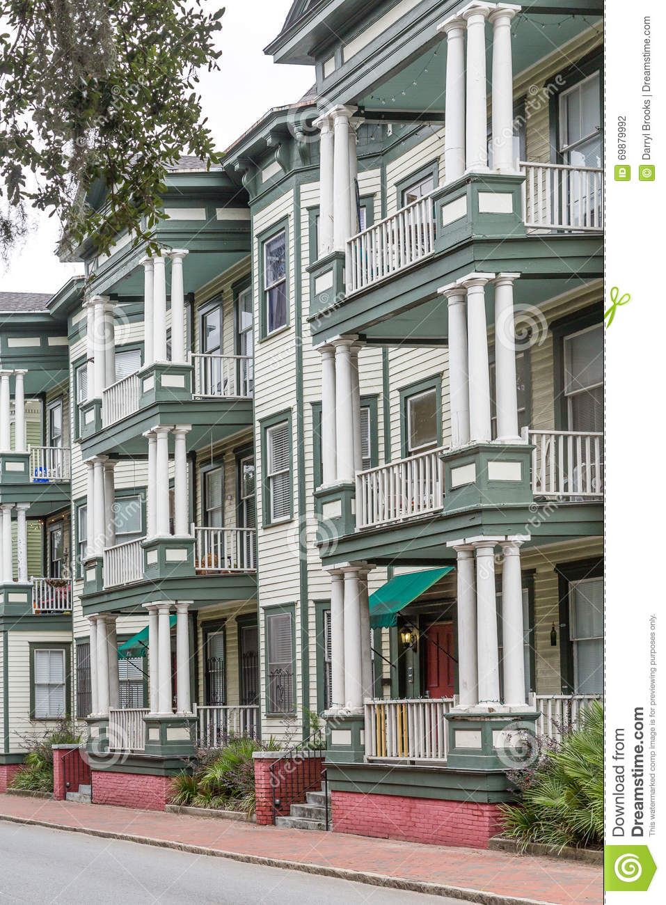 Homes With Columns old green and white homes with columns and balconies stock photo