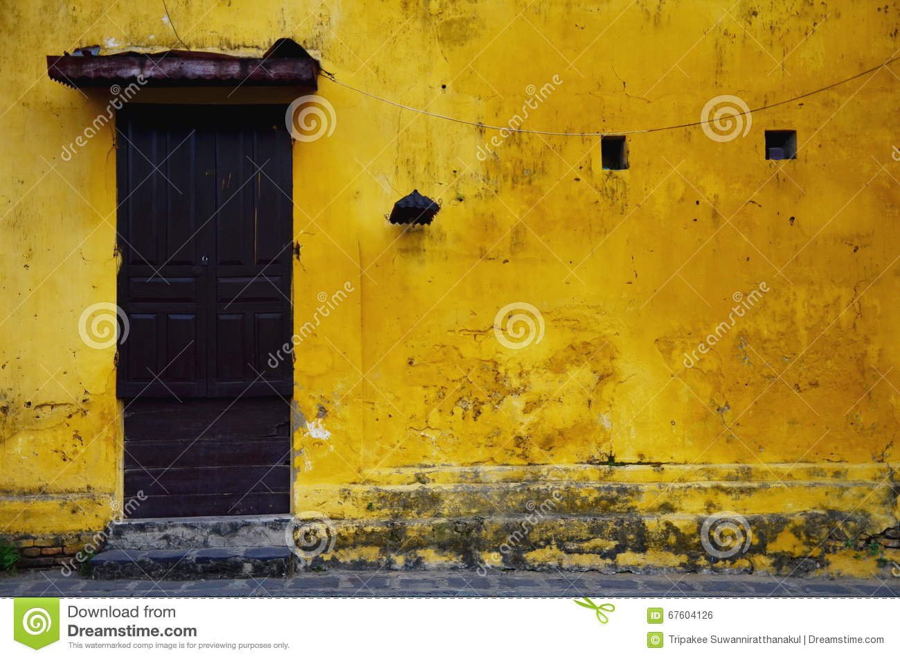 Old and grungy yellow wall