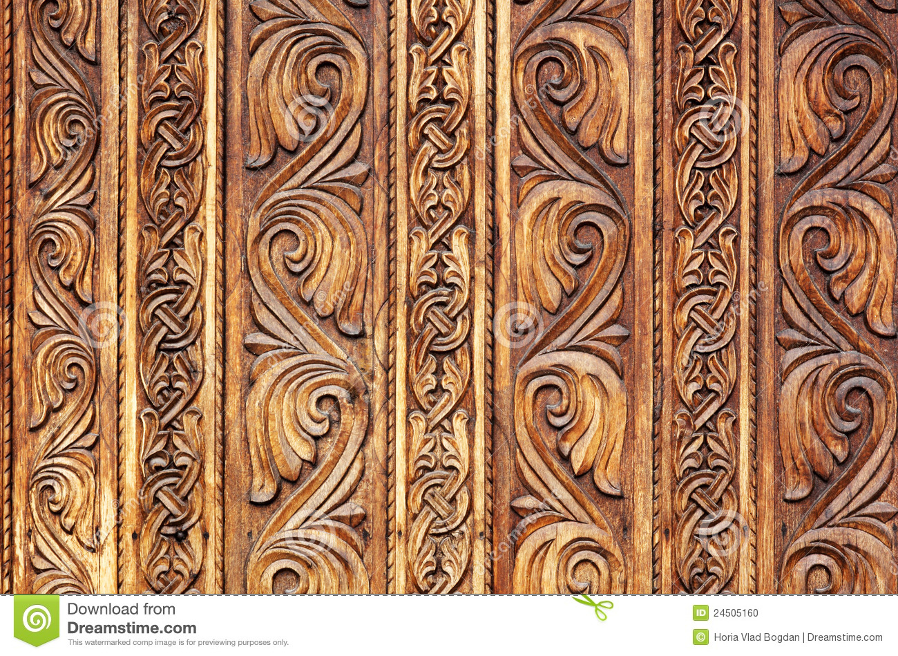 Old hand carved wooden pattern on a monastery door stock for Wooden door pattern