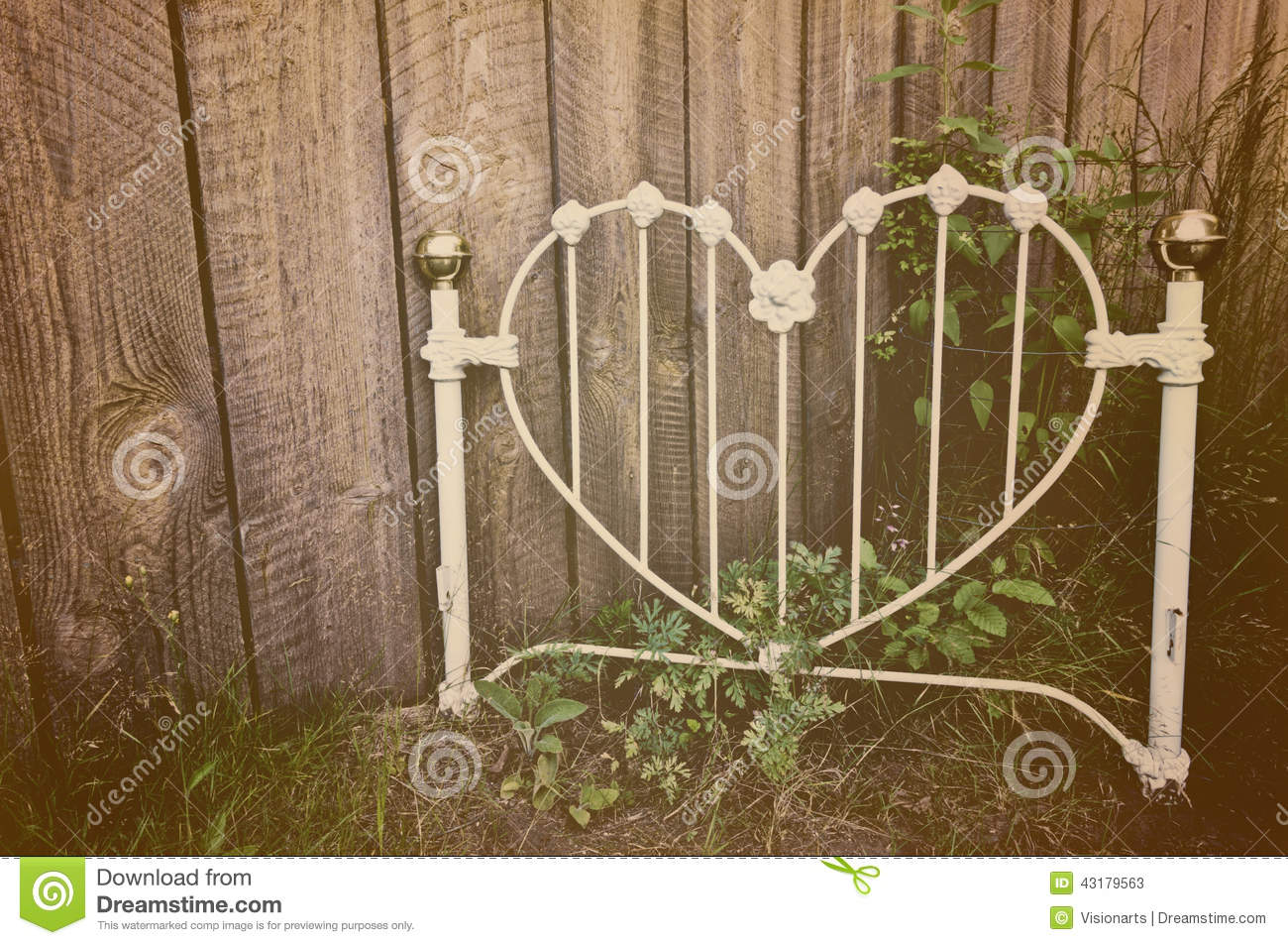 Old Heart Shaped White Wrought Iron Headboard Stock Photo