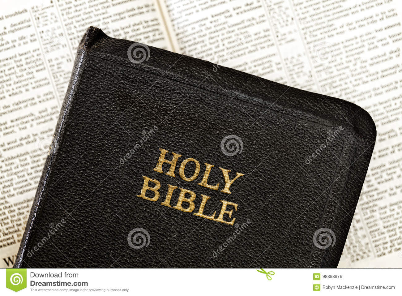 Old Bible over Blurred Open Book