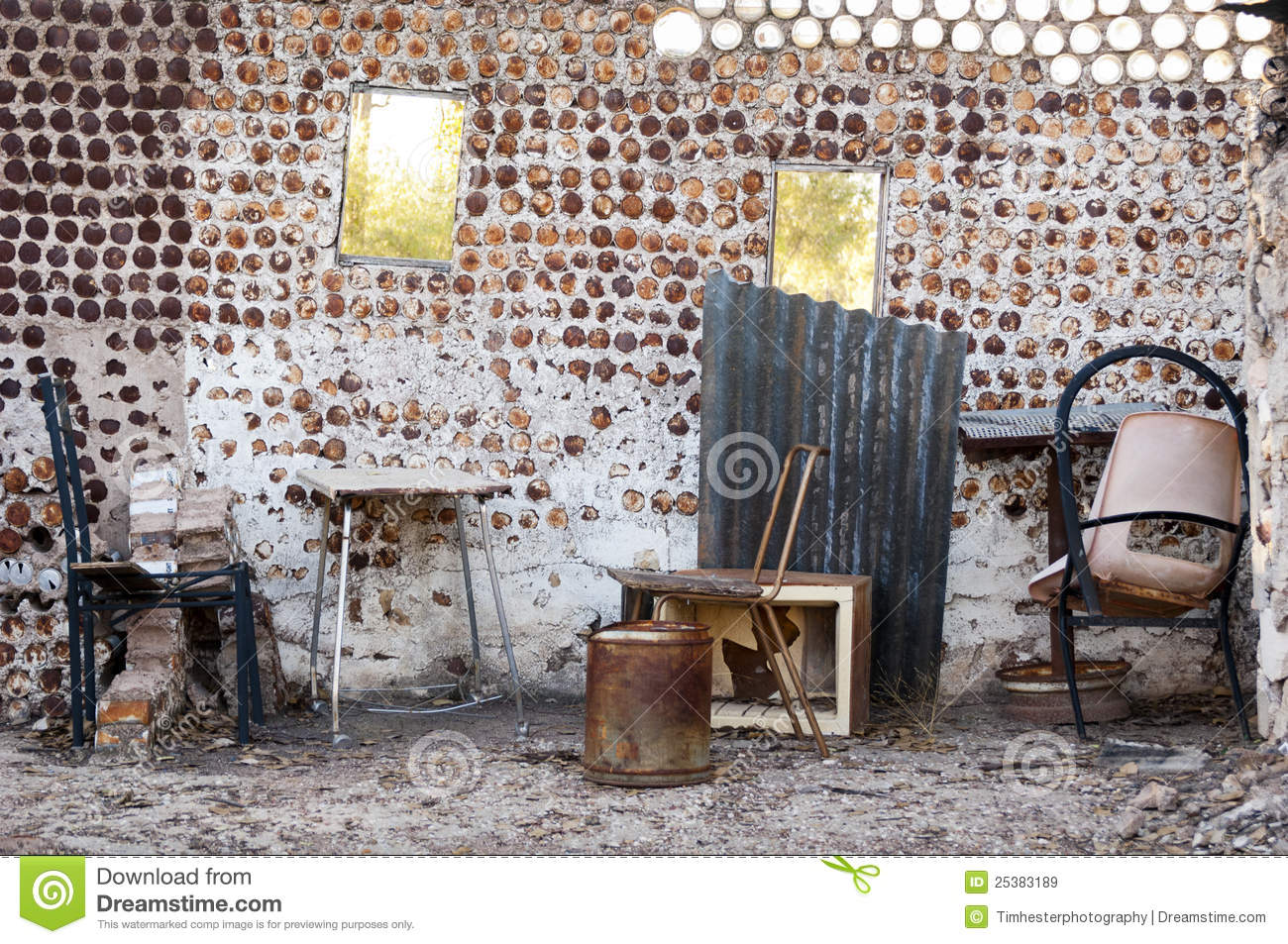Interior of an old home built from tin cans with old furniture.