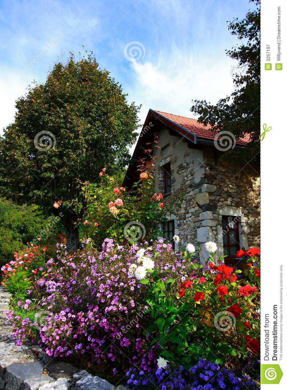 Old house and flowers royalty free stock photography for Classic house with flower garden