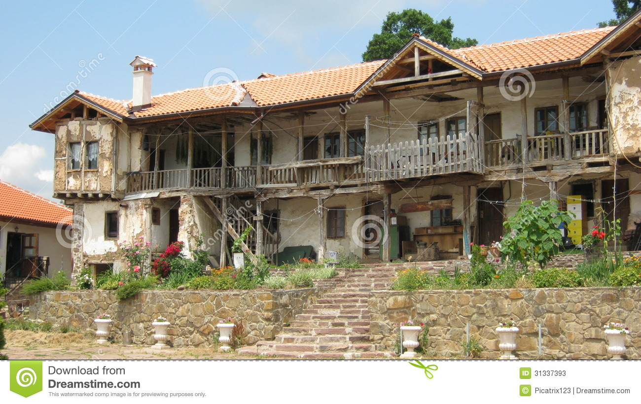 Old house with garden and beautiful stone vases stock for Beautiful classic houses