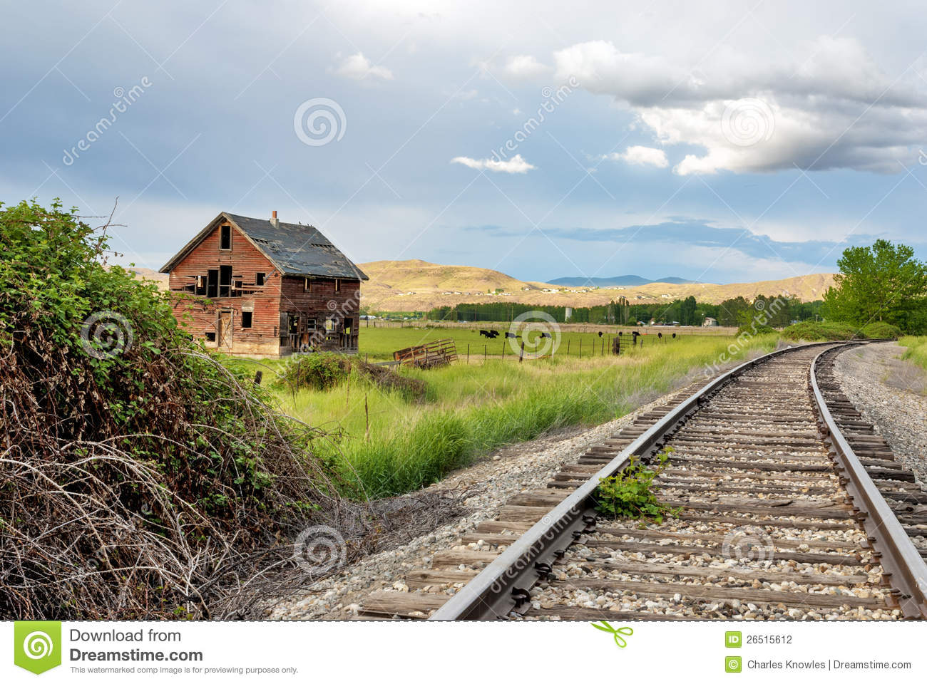 old house and railroad tracks stock photography image