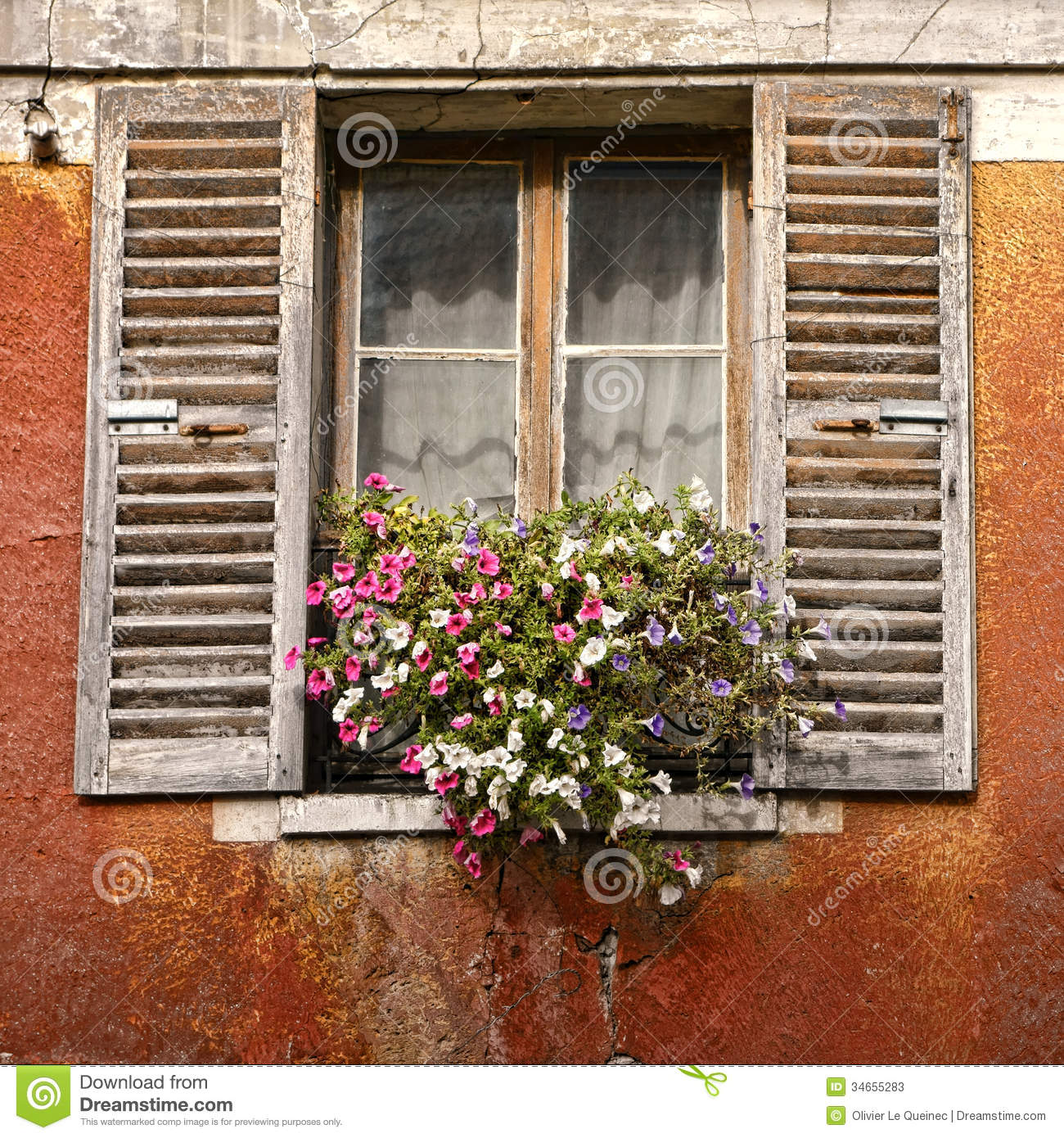 Old House Window with Flowers and Antique Shutters