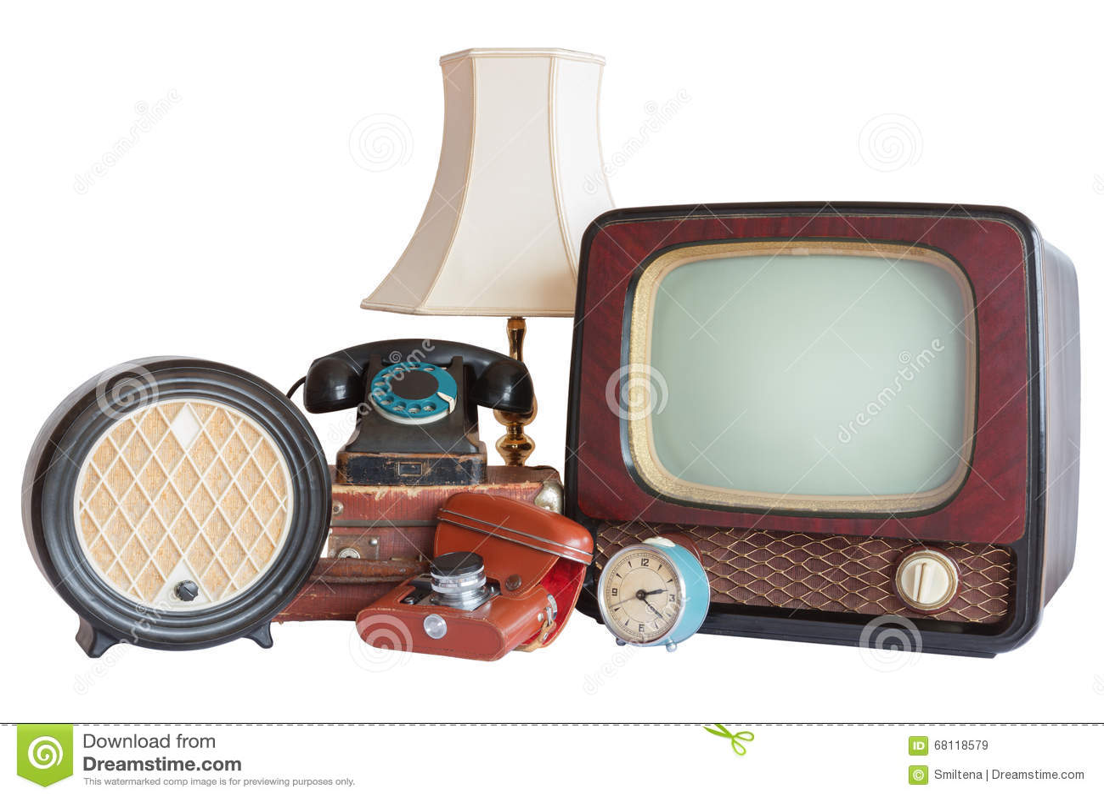 Old household items: TV, radio, camera, alarm, phone, table lamp
