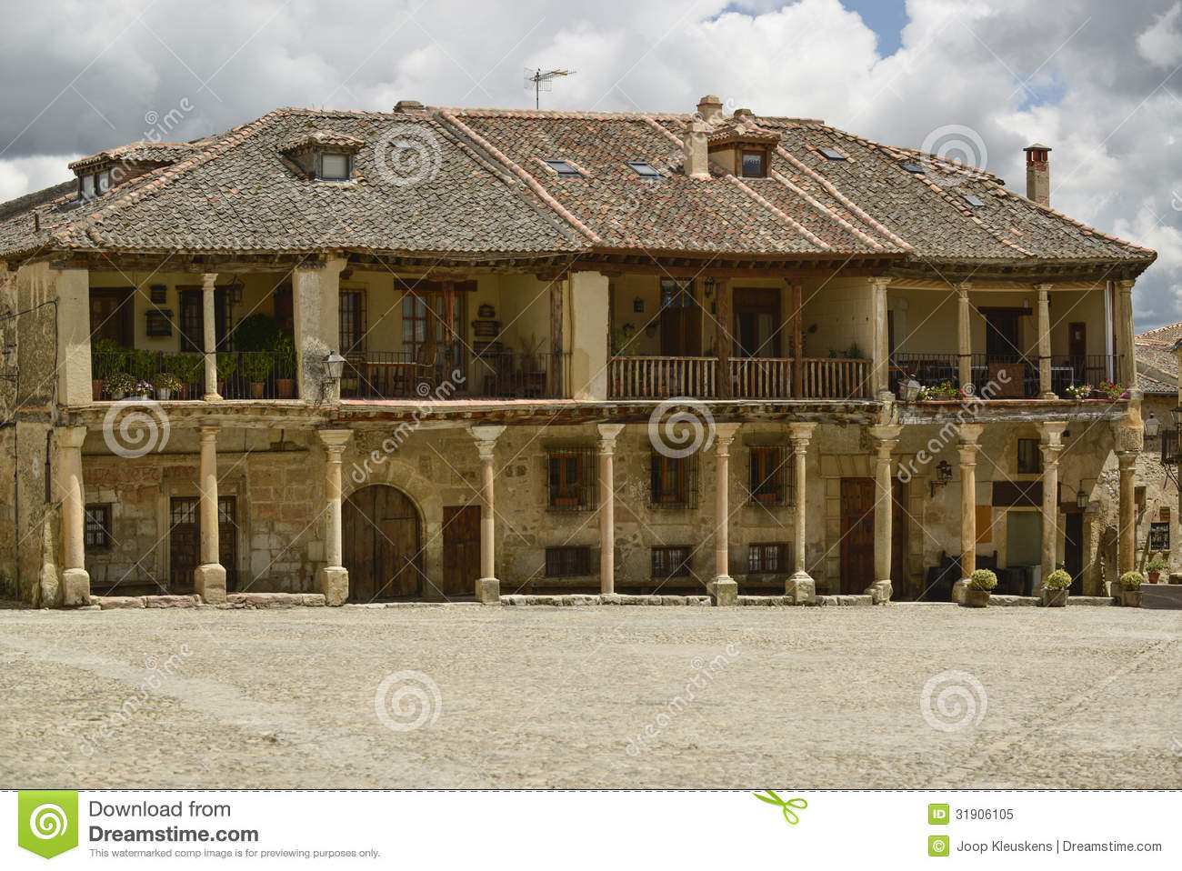Old Houses With Balcony On Pillars Royalty Free Stock