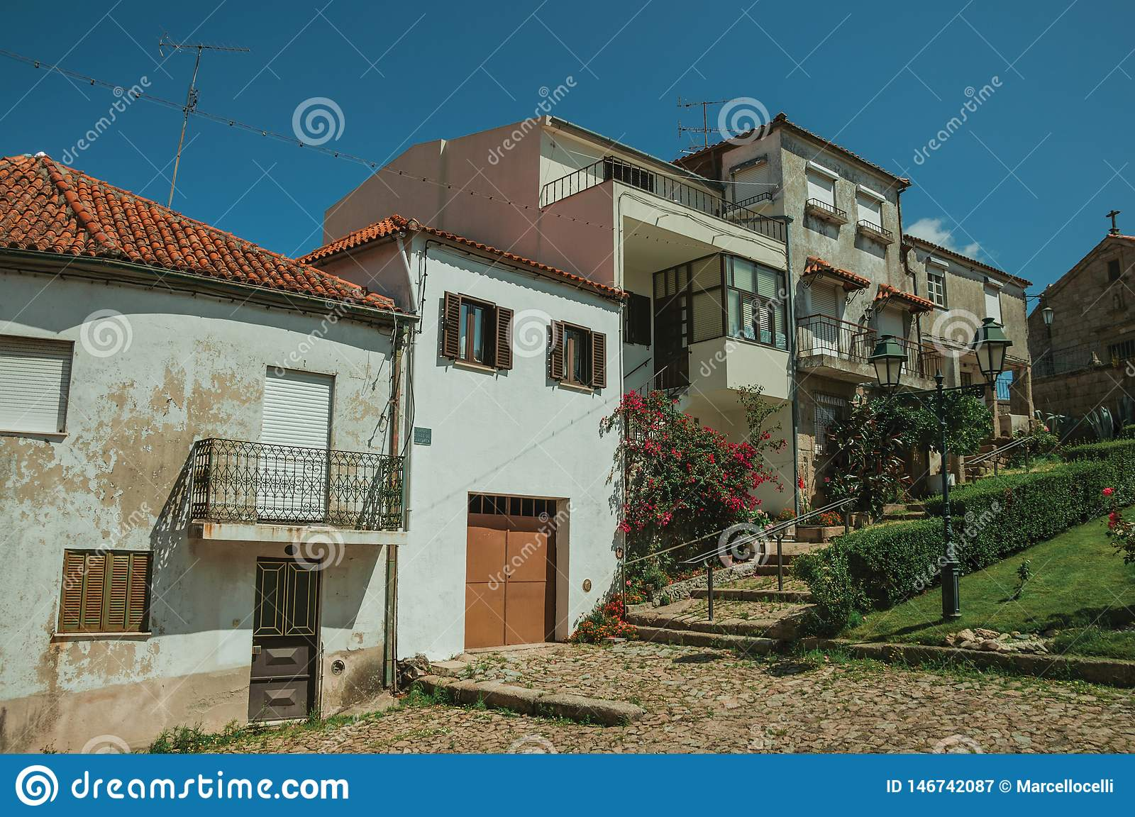 Old houses in small square on slope with steps