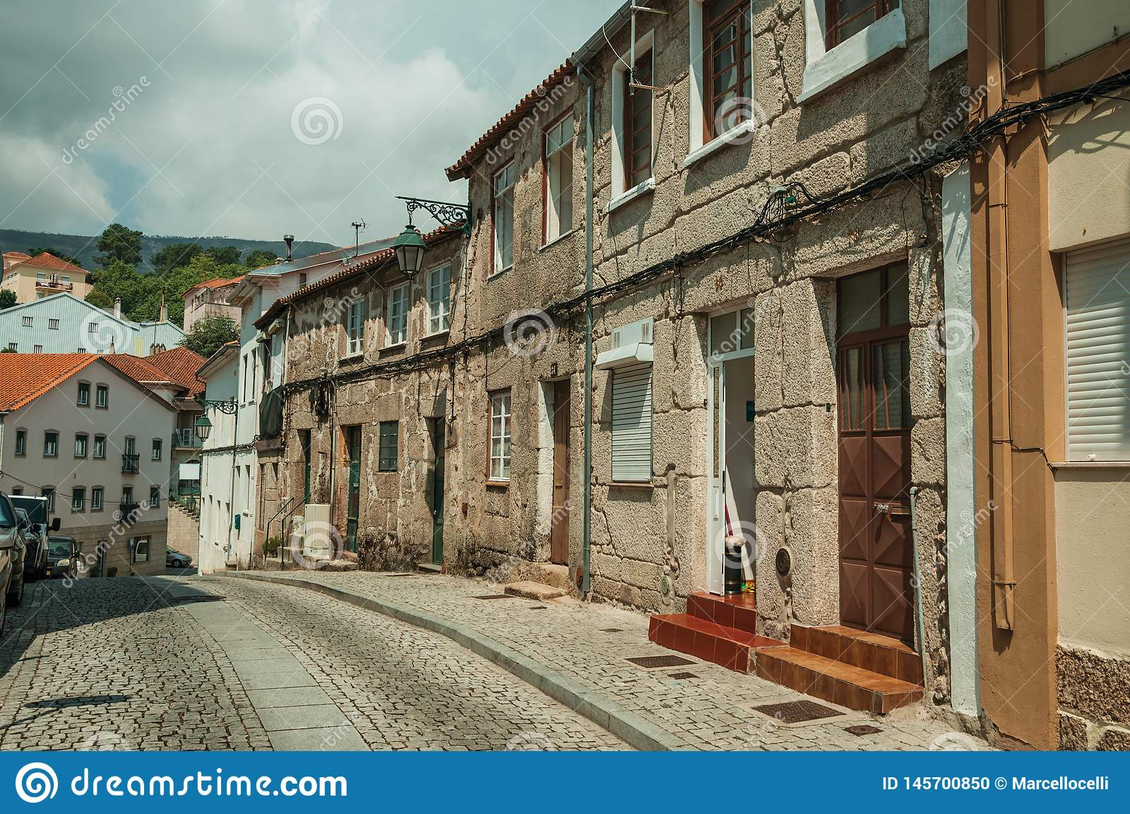 Old houses with stone wall in a deserted alley