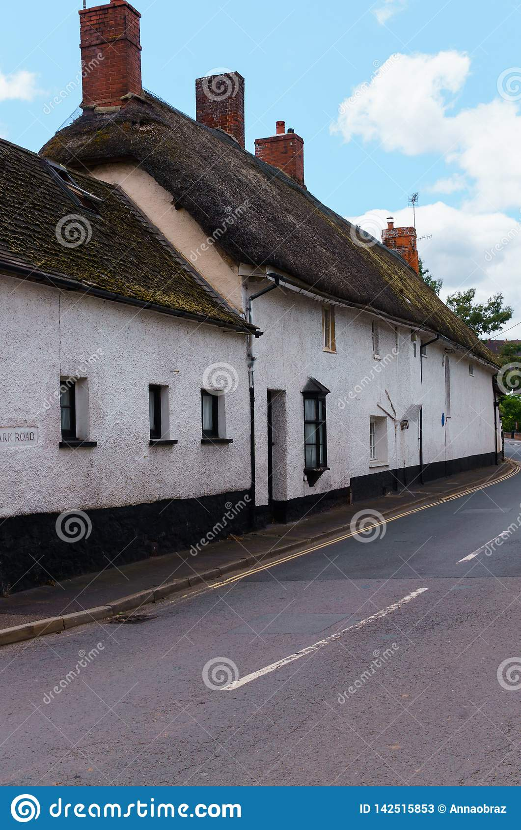 Old houses under thatched roof in the city of Crediton, Devon, United Kingdom June 2, 2018