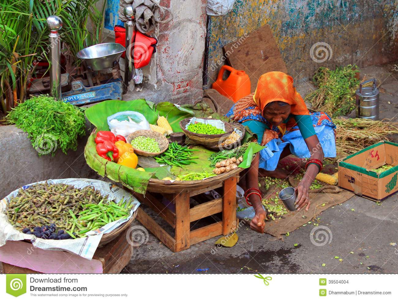 Old indian woman selling the vegetables