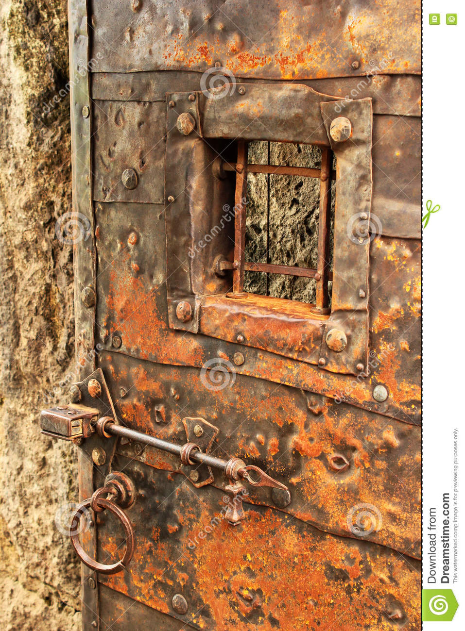 Old Iron Clad Door With Grilled Window Bar Lock And Ring