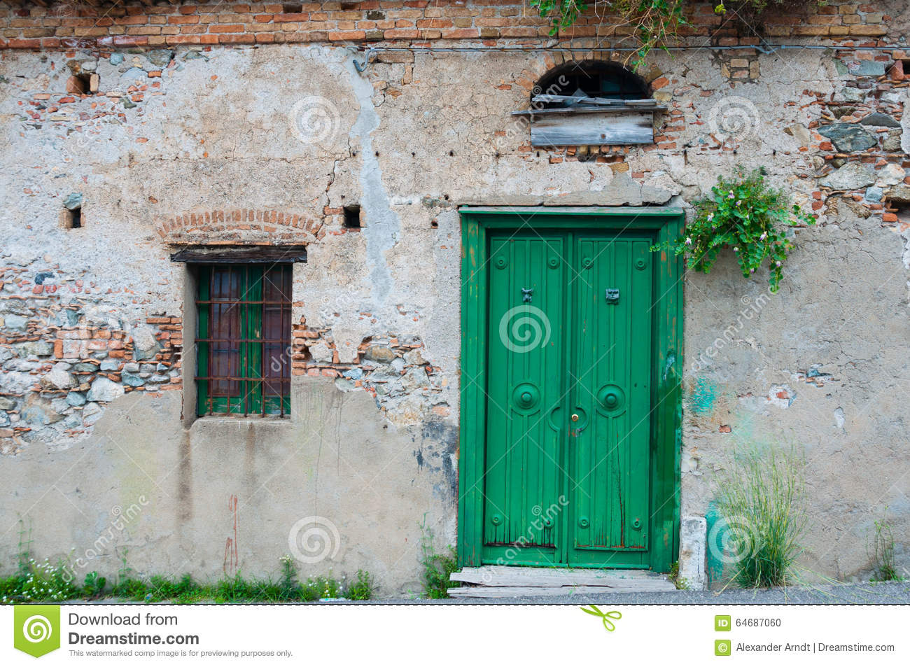 Wooden front door of old stone brick house royalty free for Classic house green street