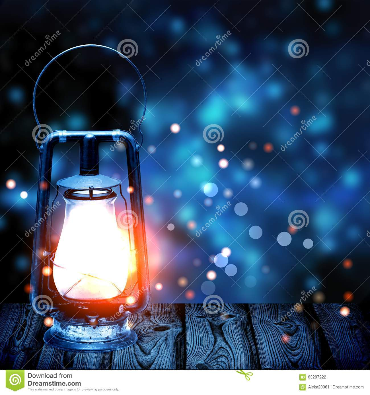 Old Kerosene Lamp Shining In The Dark Blue Blur In The