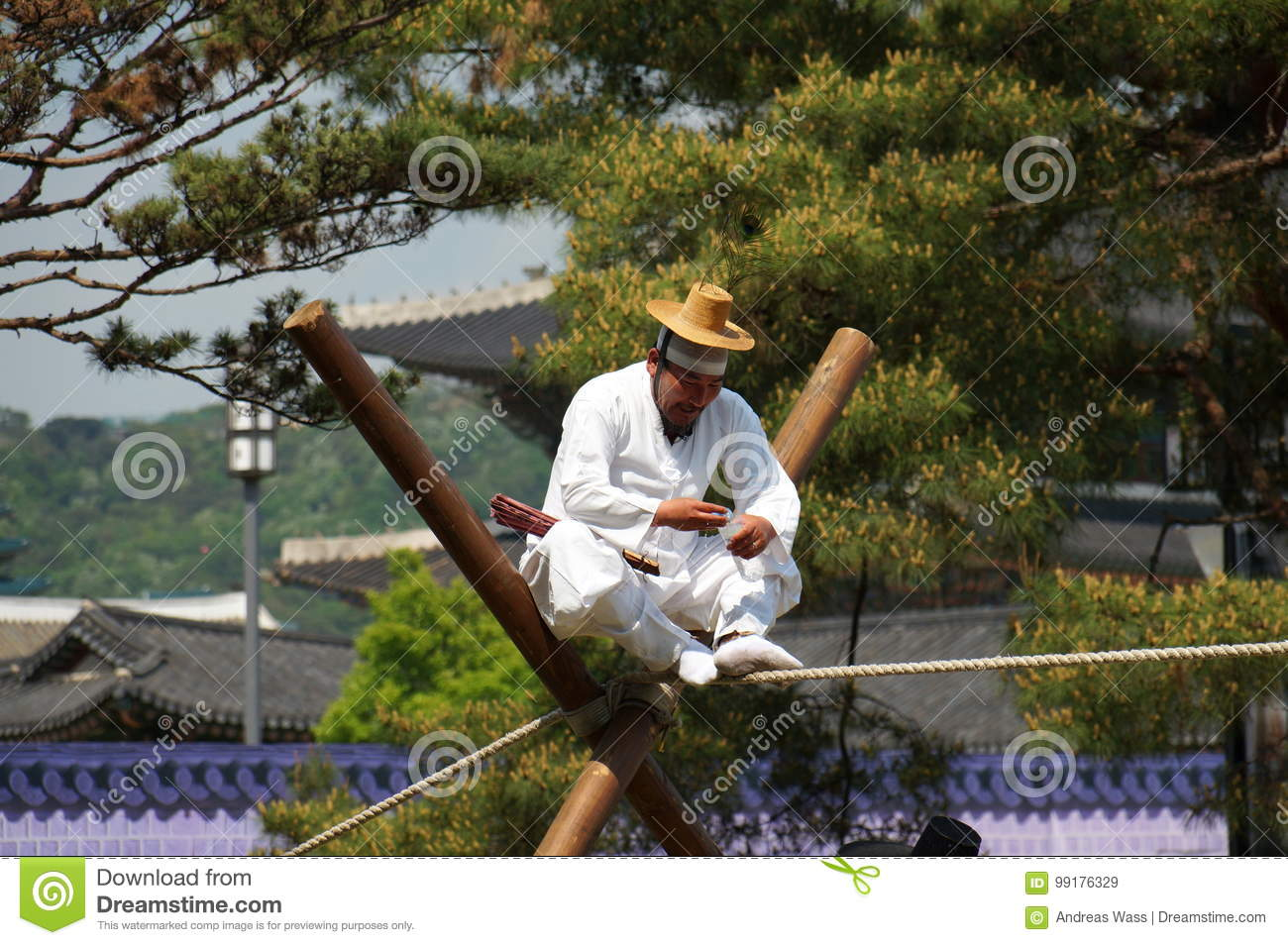 Old korean man performes on the tightrope