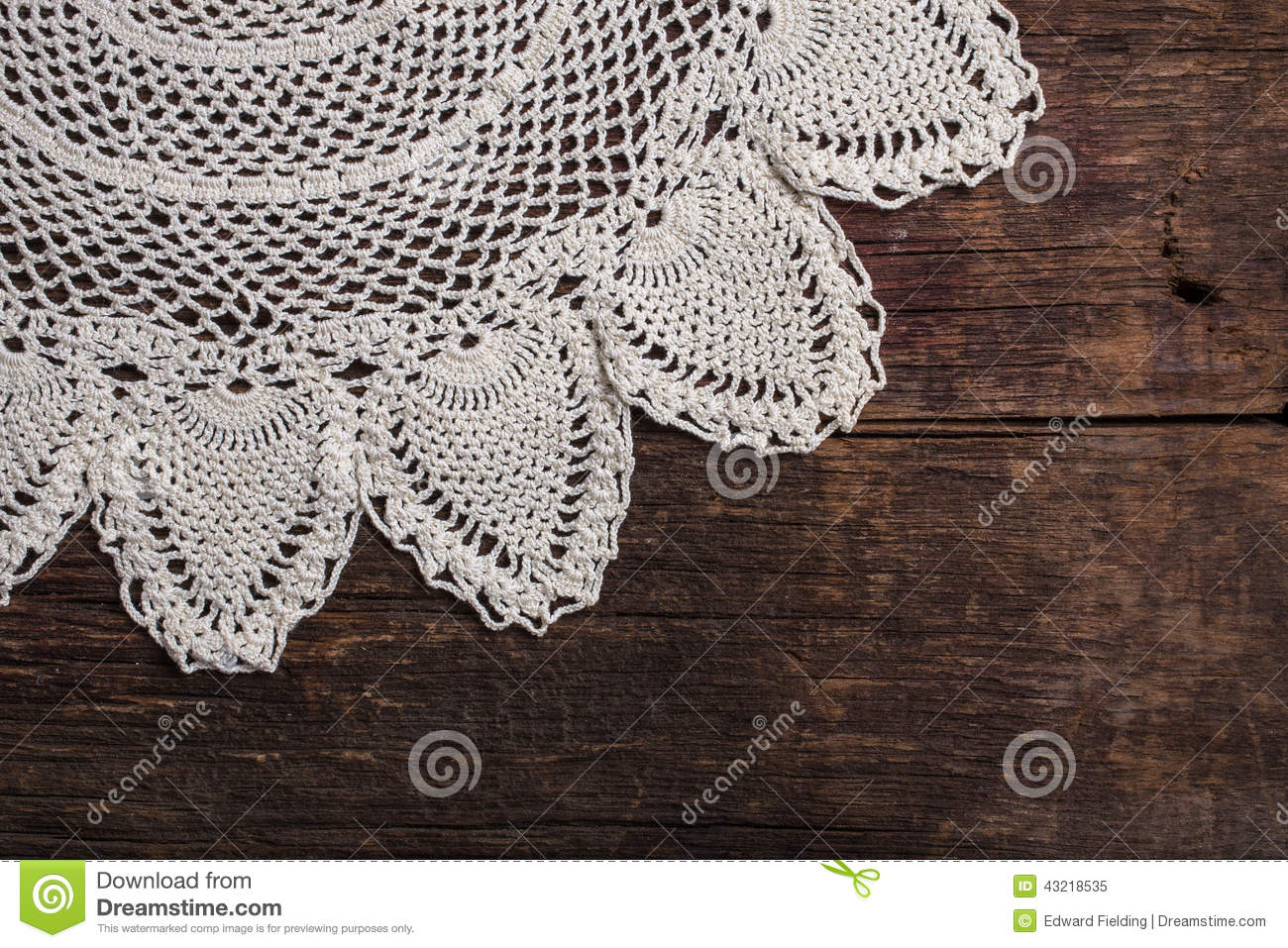 A Background With An Old Antique Handmade Lace Over Rustic Barn Wood