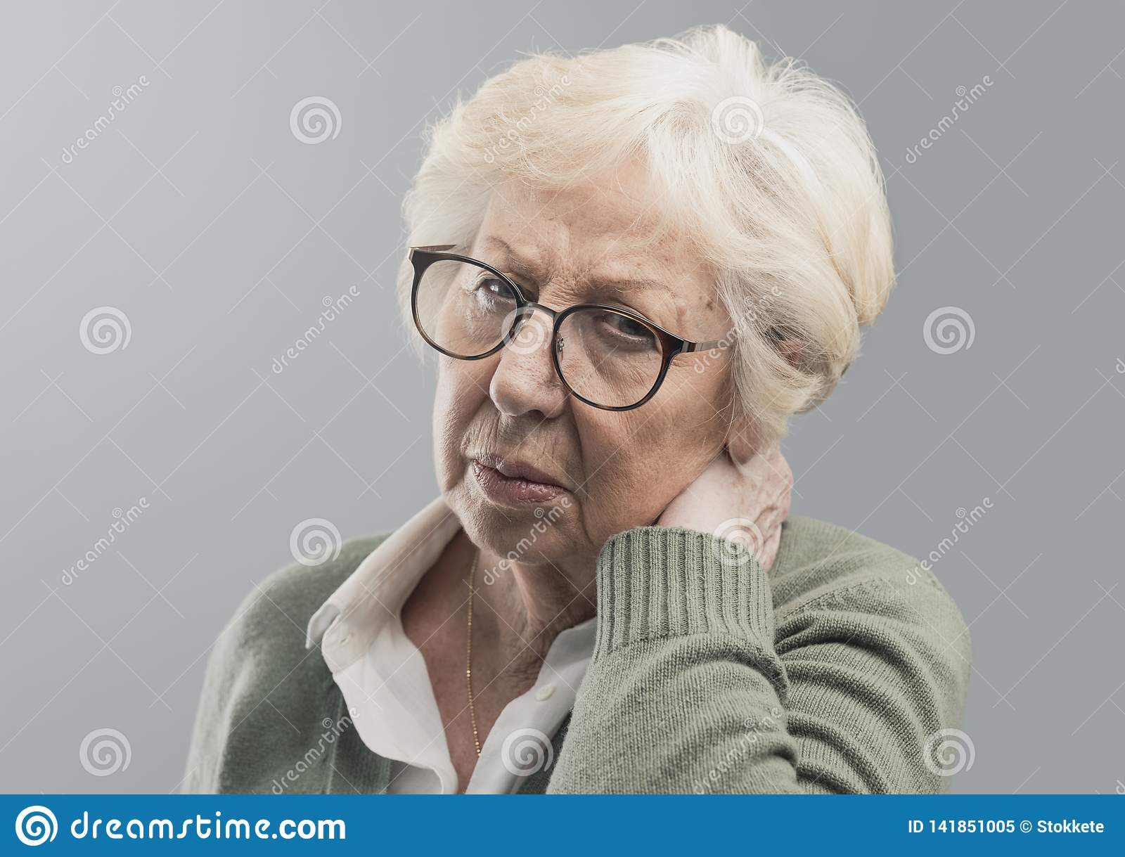 Old lady suffering with neck pain
