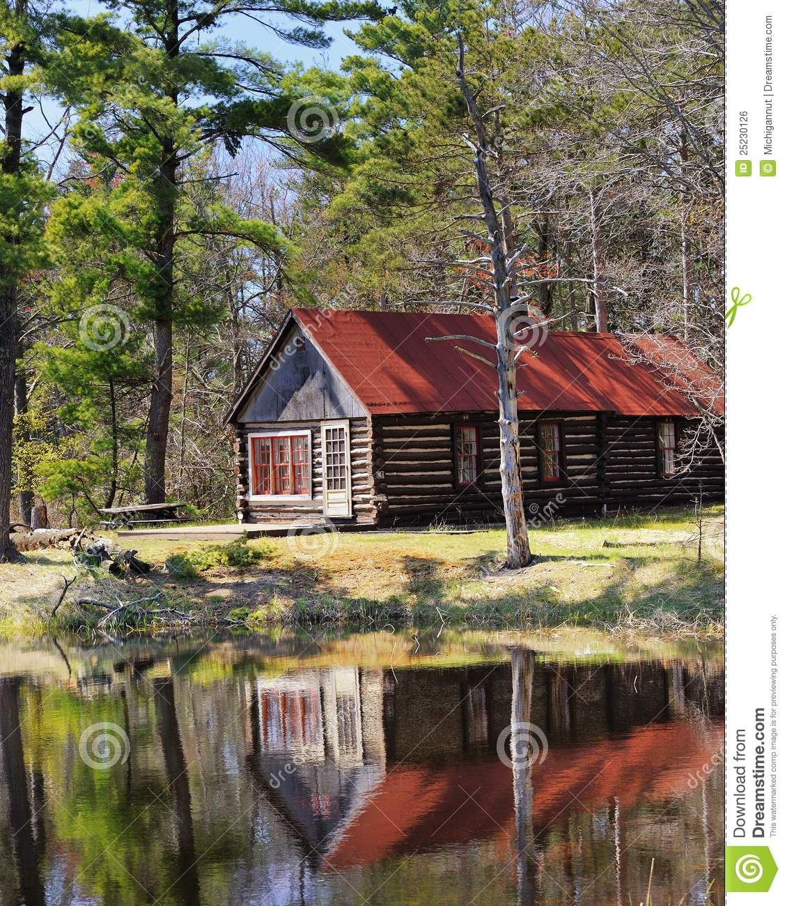 Colorful Lake Michigan Cottage: Old Log Cabin In Michigan Forest Stock Photo