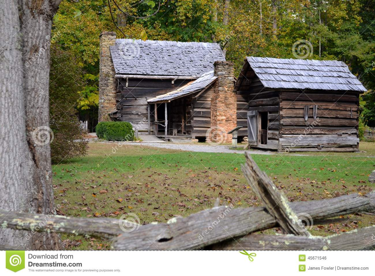 Old Log Farm House And Utility Building In The Valley