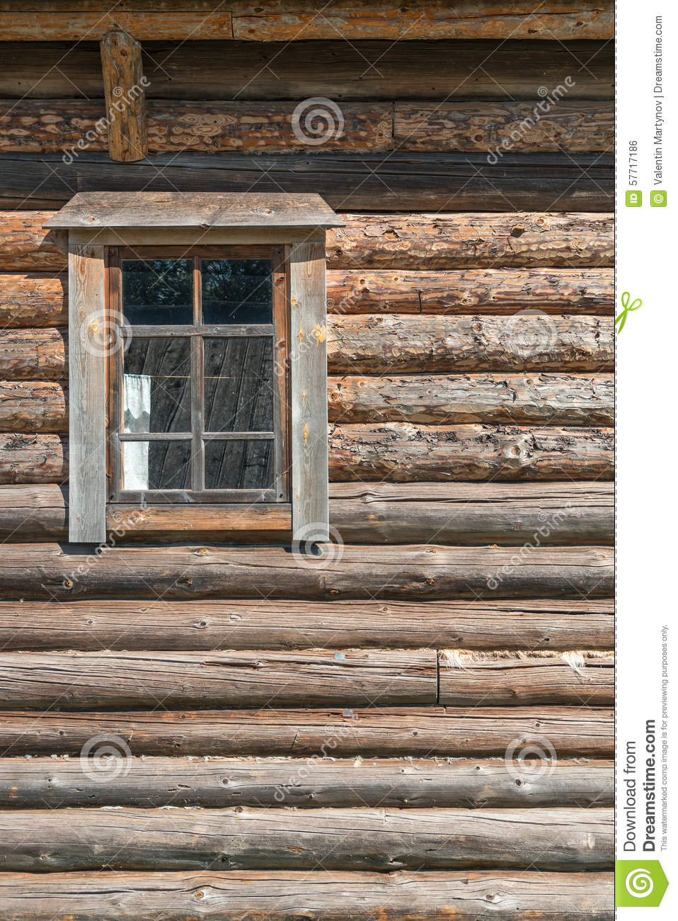 Old log house wood wall with window half closed
