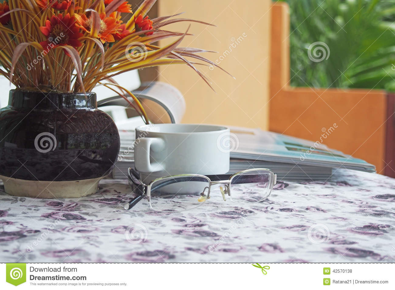 Old long-sighted glasses and coffee cup