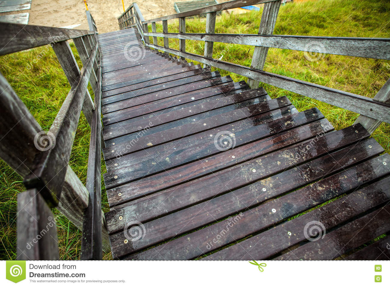 Old long wooden steps to beach of the North Sea