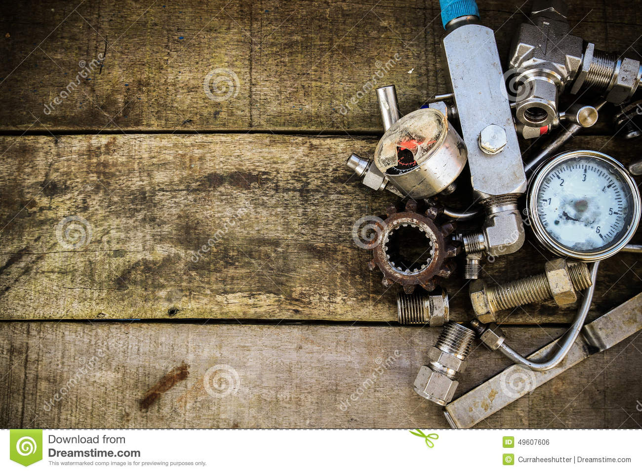 Hq Old Machinery Parts : Old machine parts in machinery shop on wooden background