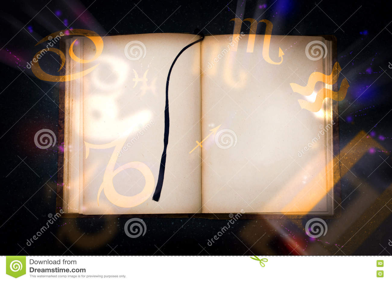 Old magic book with glowing zodiac symbols