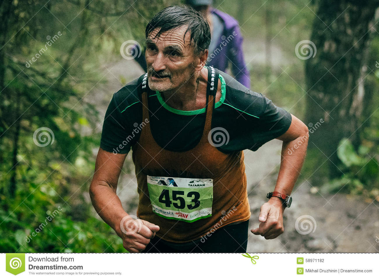 Old male athlete running