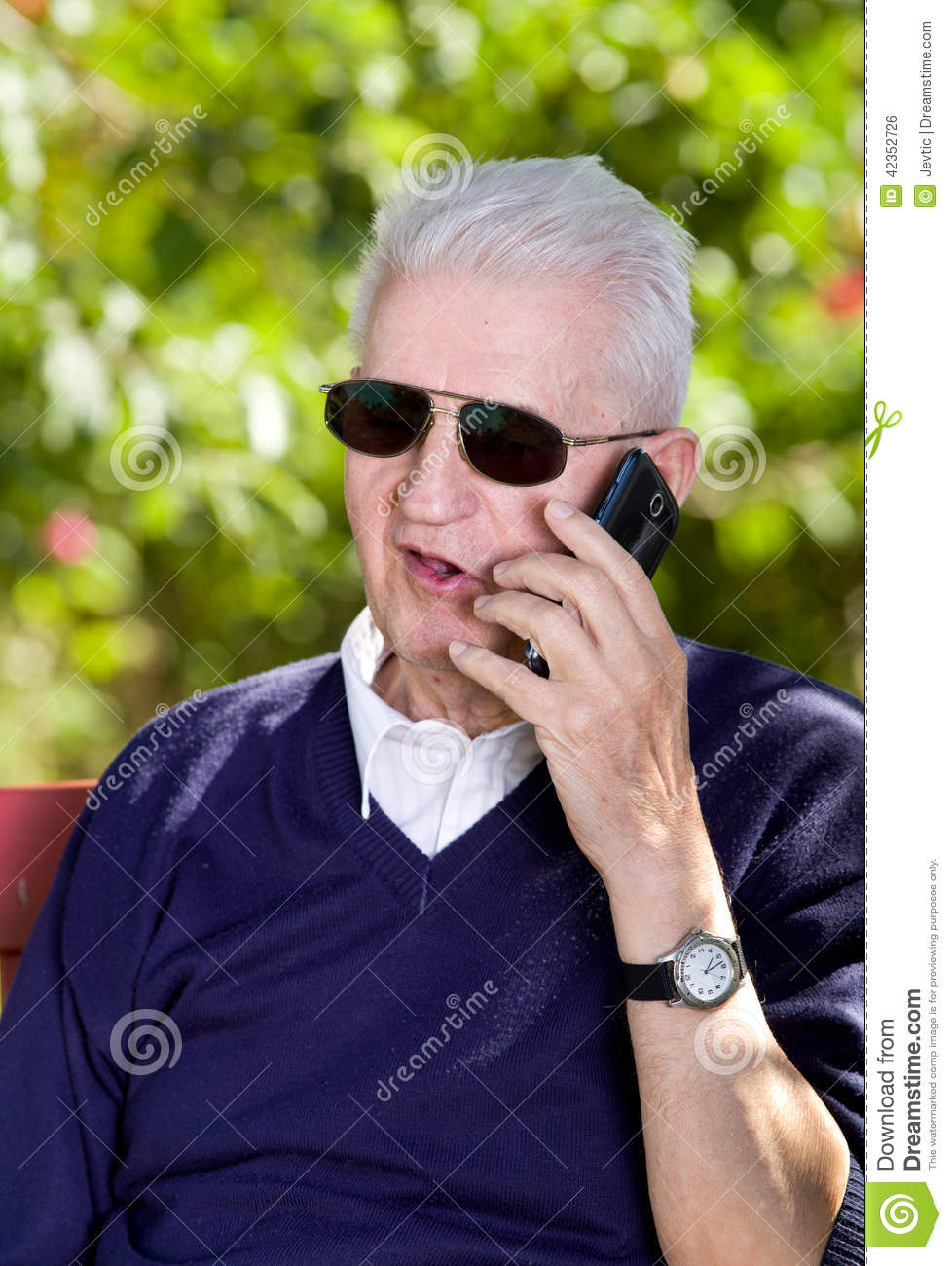 Man On Cell Phone : Old man with cellphone stock photo image