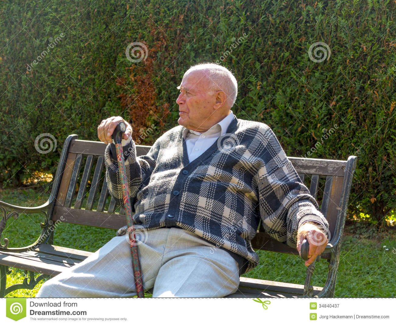 Old Man Enjoys Sitting On A Bench Stock Image - Image ...