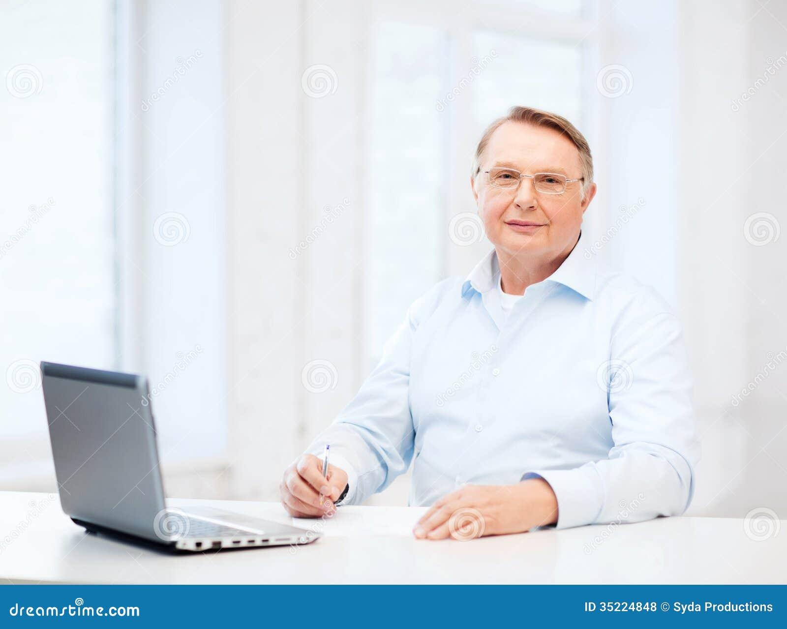 old man in eyeglasses filling a form at home royalty free stock photos image 35224848. Black Bedroom Furniture Sets. Home Design Ideas
