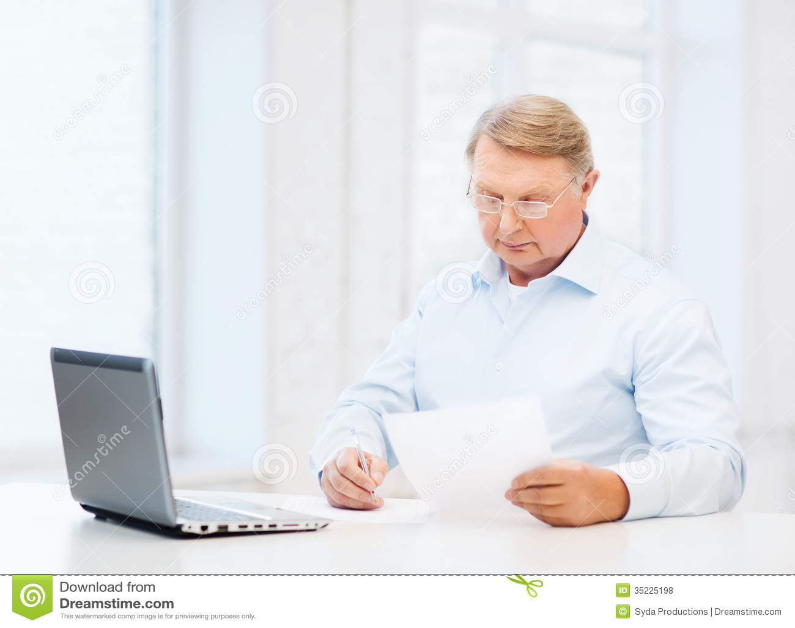 old man in eyeglasses filling a form at home royalty free stock photos image 35225198. Black Bedroom Furniture Sets. Home Design Ideas