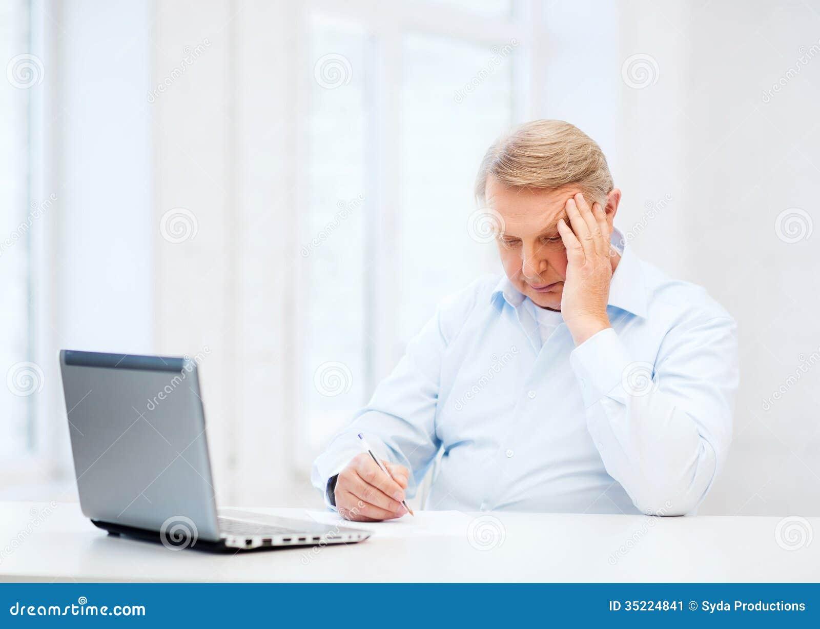 old man filling a form at home stock image image 35224841. Black Bedroom Furniture Sets. Home Design Ideas