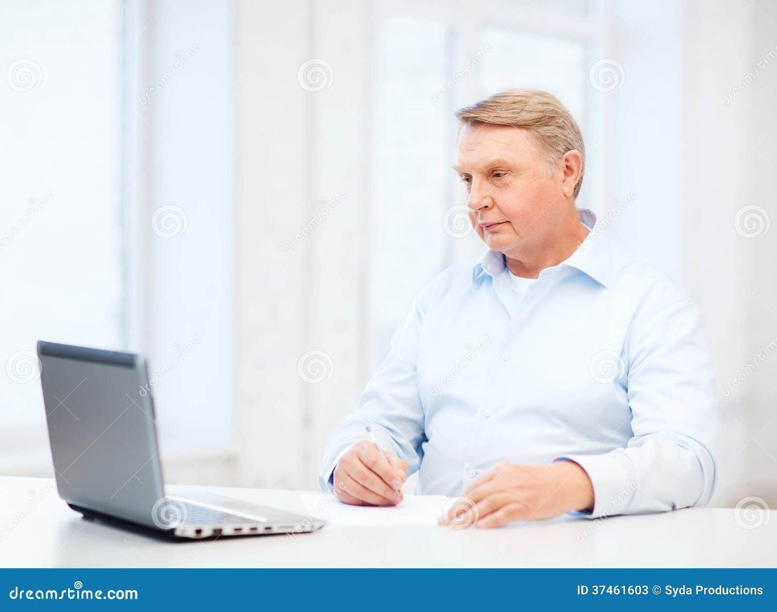 old man filling a form at home stock photos image 37461603. Black Bedroom Furniture Sets. Home Design Ideas