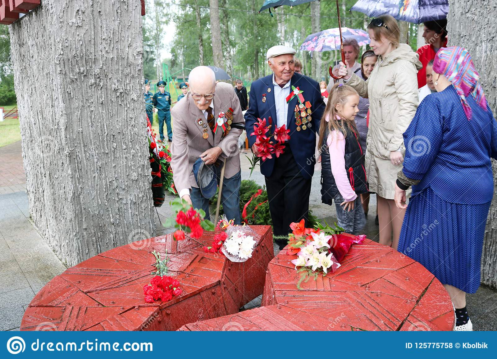 Old man grandfather veteran of World War II in medals and decorations puts cents Victory Day Moscow, Russia, 05.09.2018