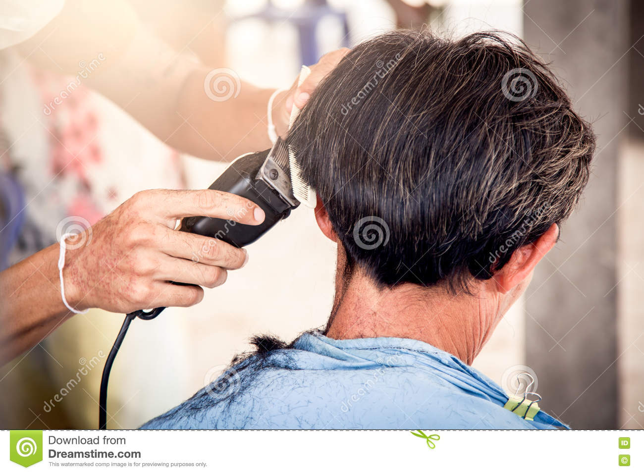 Old Man Having A Haircut With A Hair Clippers In Barber Shop Stock ...