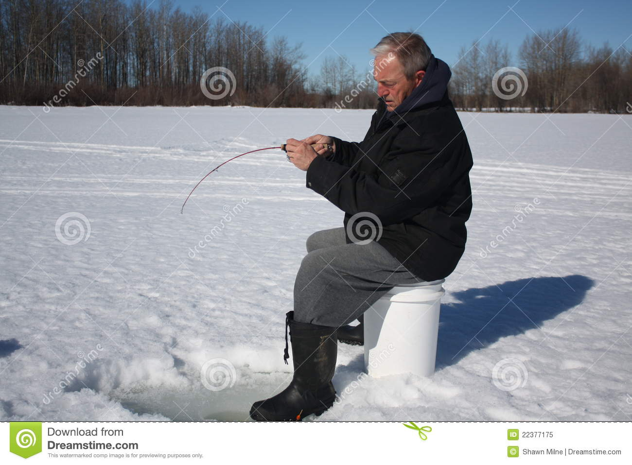 Old man ice fishing 3 stock image image of pike angler for Ice fishing videos