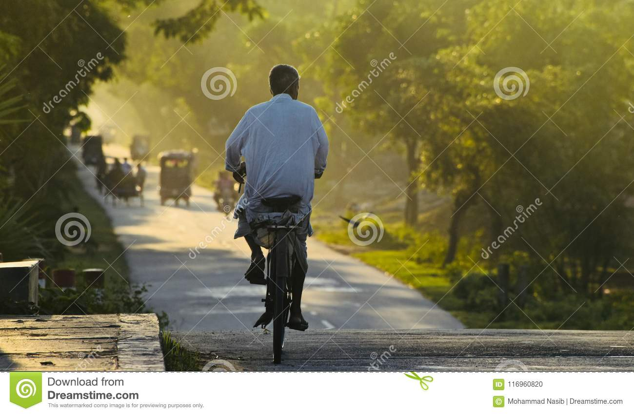 Download An Old Man Riding A Bicycle On A Highway Road Editorial Image - Image of sunlight, bicycle: 116960820