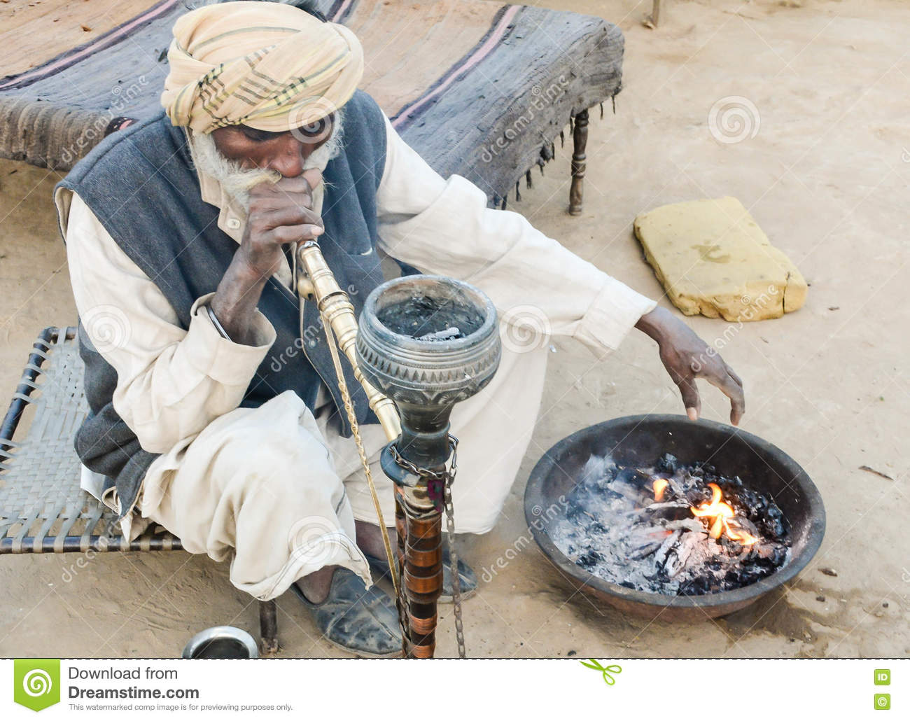 Old man in traditional attire in Indian village